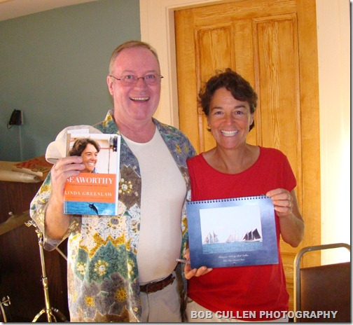 Bob with Linda Greenlaw's new book, and Linda with Bob's new 2011 Gloucester calendar.