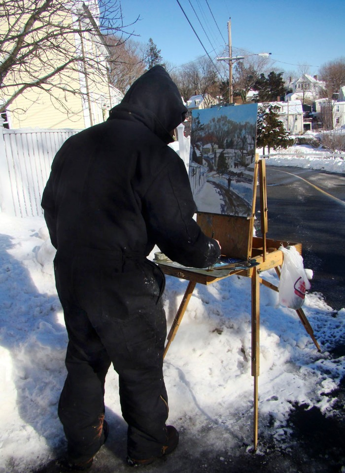 photo of painter Chris Coyne painting Annisquam Village En Plein air on a very cold January day