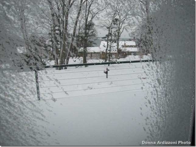 Snow on my windows looking across the street