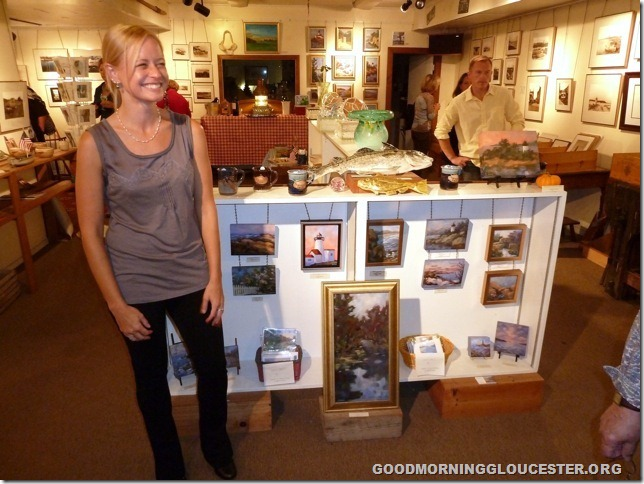 Kathleen Miller with some of her paintings