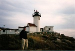 Frank in shadows of Gloucester's Eastern Point Lighthouse with many beautiful Lobster buoys.