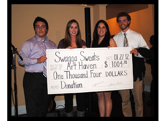 Swagga Sweats presents their donation to Art haven at the Buoy Auction
