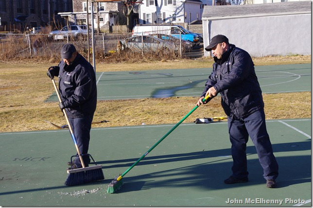 CleanPro guys sweep court