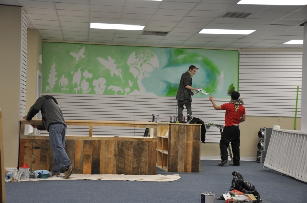Working on Eco Boutique mural