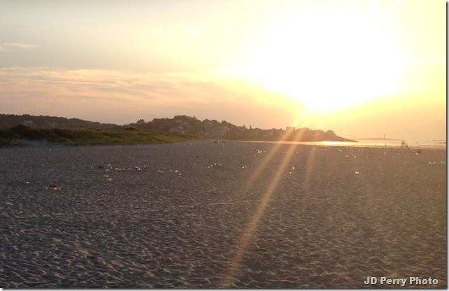 Good Harbor Beach 5:40 a.m., June 21, 2012 -- sparklers on sand are hundreds of discarded plastic bottles.  Sad.