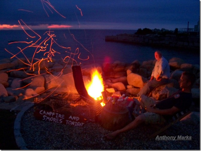 Bill and David tend the campfire at the Lobster Pool restaurant.