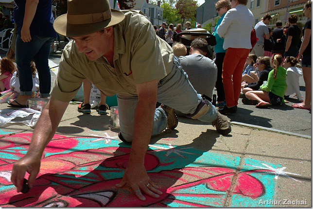 """Tom Garrity doing sidewalk chalk at at the """"Motif #1 Day"""" festival, held on May 18, 2013 in Rockport, Mass. Tom is a resident of Rockport."""
