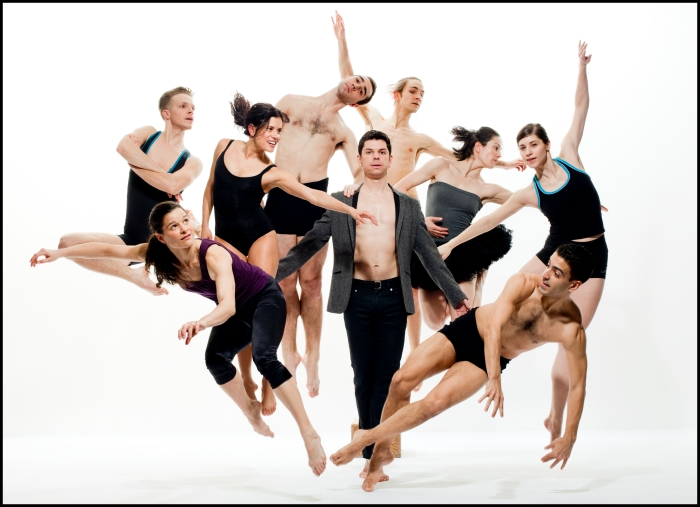 Group photo of the dance company performing