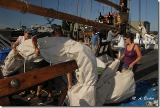 Amistad crew move the foresail