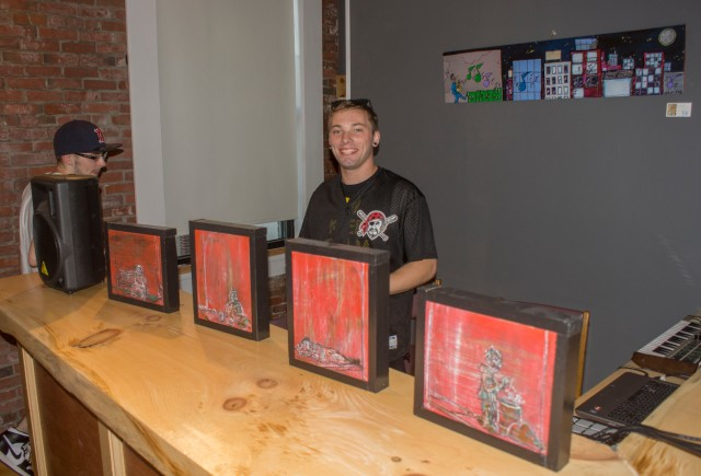 Jason with some of his art