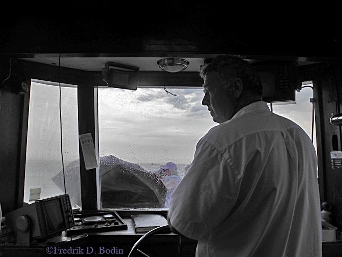 King Eider Captain Steve Douglass brings us thru a rain squall to the Gloucester Schooner Race.