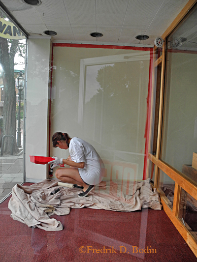 Peggy Russell, friend and owner of the POP Gallery, gets started on my starboard window.
