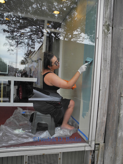 Vignette Lammott of the POP Gallery starts painting the walls in the port side window. This whole operation was huge for me! They did the work and I was their gopher.