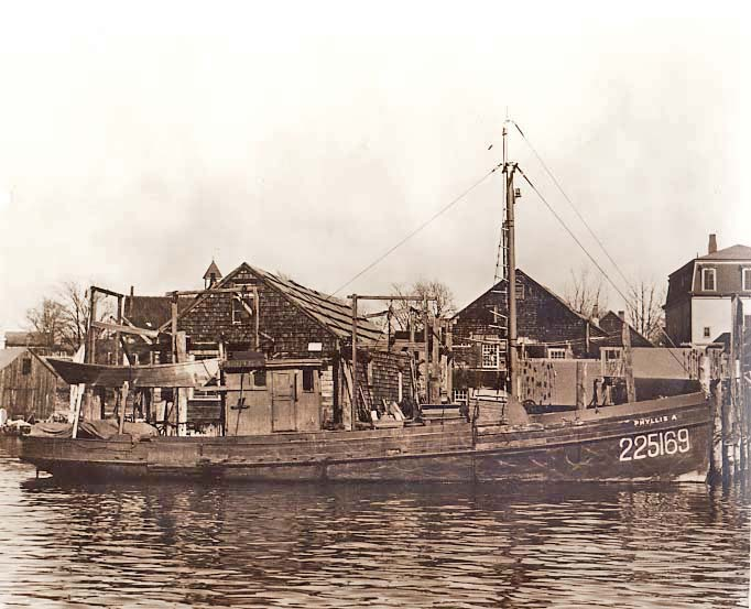 Gillnetter Phyllis A. (ID#225169) tied up in East Gloucester. Built in 1925  You can see houses on East Main Street in the background. Photo by Robert M. Fairweather.
