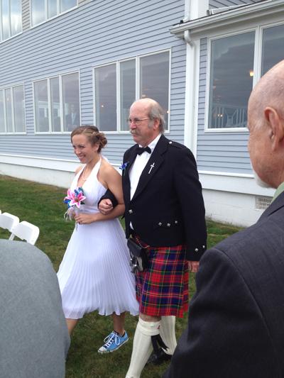 Rhettt Heberling, of Detroit, walks out his daughter in his MacPhereson tartan.