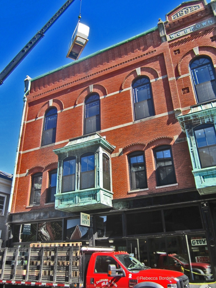 Verizon installing cell tower equipment on the WG Brown building  at the  corner of Main and Pleasant Streets. Photo by Rebecca Borden, President and Interim Executive Director of Art Haven.