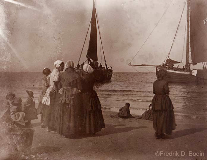 I printed this from a very old glass negative. I think the women and children are there to do more than wave and say welcome home. They'll be transporting the fish to market and home to eat.  Where do you think this is?