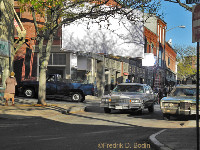 Here's a view of today's shoot at the corner of Main and Center Streets. From what I could glean, the filming was mostly drive-by's with 70's and 80's cars, all with Maine plates. They'll be working here tomorrow and the day after. Interesting for me, but not much business.