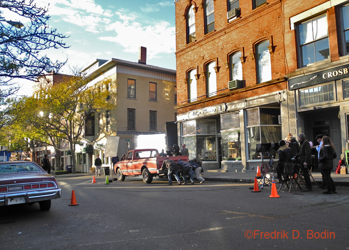 Here's the last scene of the day, the firewood truck driving away. It was being pushed for whatever cinematic reason. There was supposed to be a kitten in the scene, but I never saw it. Notice the unusual reflection on the side of the building across Center Street (where Gabriel's Antiques is).
