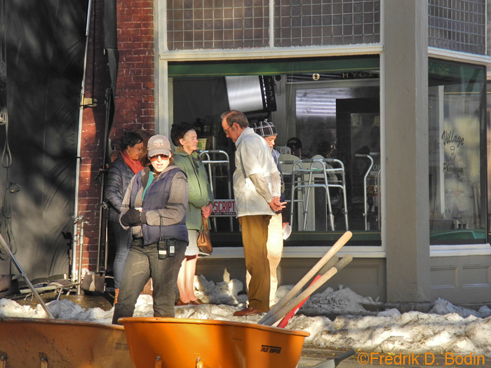 Today was the last day of filming Olive Kitteridge on Main Street. I don't want to be redundant with the snow and production shots. Here are cast members taking a break outside the pharmacy, including the pharmacist. The wheelbarrows and shovels are for moving the snow.