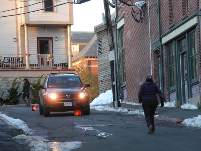 """The """"no truck."""" This SUV plowed thru 4 traffic cones and was dragging one toward the set. The young woman on duty stopped them and put them on the right course. She also reset all of the orange cones at the top of Center Street."""