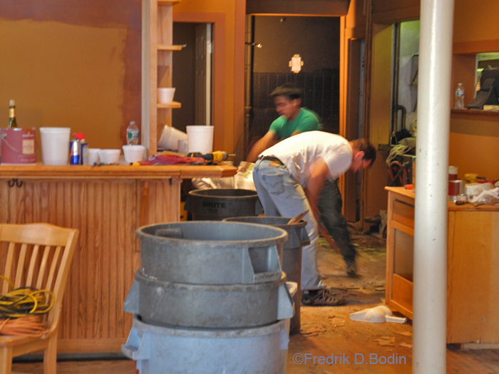 Here, owner and chef Eric Lorden, in the white t-shirt,  is pulling up 100+ years of flooring with a claw hammer. Eric and his construction crew are going petal to the metal, and hoping to open in a couple of weeks.