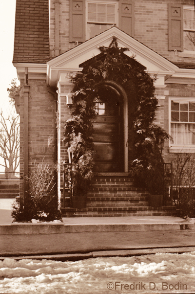 Willard Pike's Christmas doorway, 1935. This photo was taken on Pine Street. Pike's funeral home is now the Pike-Grondin Funeral Home at 61 Middle Street. There's a little snow, like we have now.