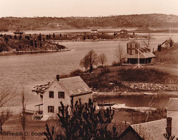 You've seen Trenel Cove on Wolf Hill many times, commuting onto or off of Cape Ann island. The A. Piatt Andrew Bridge (Route 128) connects us with the mainland. It spans the Annisquam River from Rust Island on the left to just beyond the house with the turret on the right (Wolf Hill). Trenel Cove is in the foreground, and was where a small ferry operated. It's now a Gloucester Public Landing (see #11): http://www.gloucester-ma.gov/DocumentCenter/Home/View/426