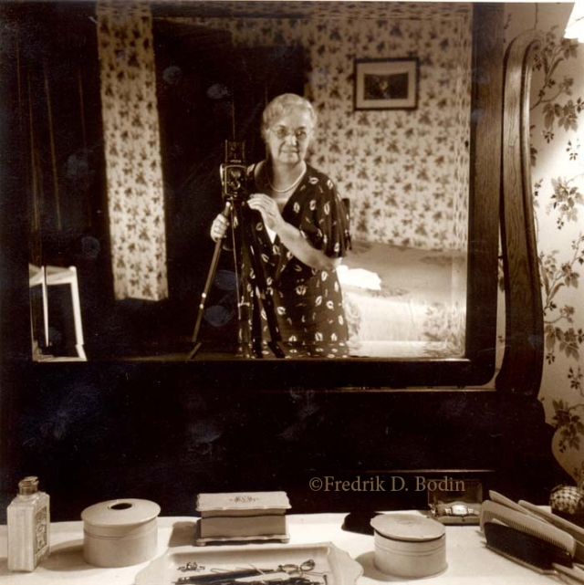 I own 4,000 of Alice M. Curtis's original negatives, and other material.  Born in Gloucester in 1871, Alice passed away in this city 90 years later. In this self portrait, she's reflected with her tripod in her dresser mirror. I think it's about time I published this photo and gave her some credit. She photographed ordinary things, such as her friends' gardens and indoor arrangements. In the future, this will be invaluable documentary coverage of how people lived at that time.