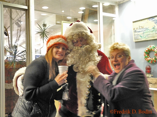 It was the traditional Ladies' Night, and they sure came out. Santa even stopped in, and here he is with up and coming painter Laureen Maher and Janet Crary. They'll both be at the preview opening party at the Magnolia Historical tomorrow: https://goodmorninggloucester.files.wordpress.com/2013/11/magnolia-historical-society-art-show-poster31.jpg