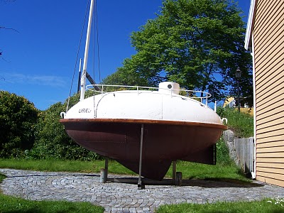 This is an accurate replica of Urad, in a Norwegian driveway. It'll give you a good idea of what she looked like before being battered by the North Atlantic. Don't forget that this was supposed to be a lifeboat, not a transatlantic vessel. I think she proved herself, right?