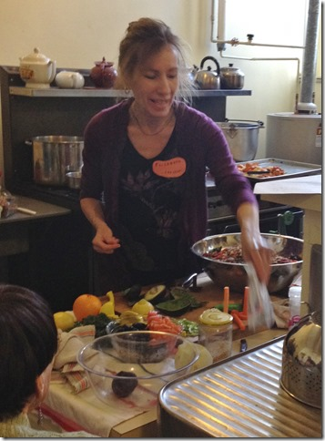 Vegan chef Elizabeth Reed demonstrates a recipe at the Gloucester Unitarian Universalist Church.