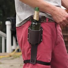 Red Envelope Leather Beer Holster.  You can even get it monogrammed so it doesn't get mixed up with your neighbor's beer holster!