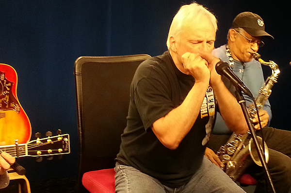 Parker Wheeler (on harmonica) with Amadee Castenell on Sax.  Guess who's on guitar?