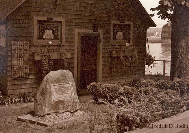 """The long-gone bronze plaque (top) commemorates oil painter Twachtman and his studio. The head of Wonson Cove is in the background. The photo on the bottom is the exterior, photographed in 1936, when it was Oharra's """"Come See & Shop."""""""