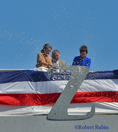 The Admiral's daughters Ann and Mouzetta break a bottle of bubbly to christen the USS Zumwalt.