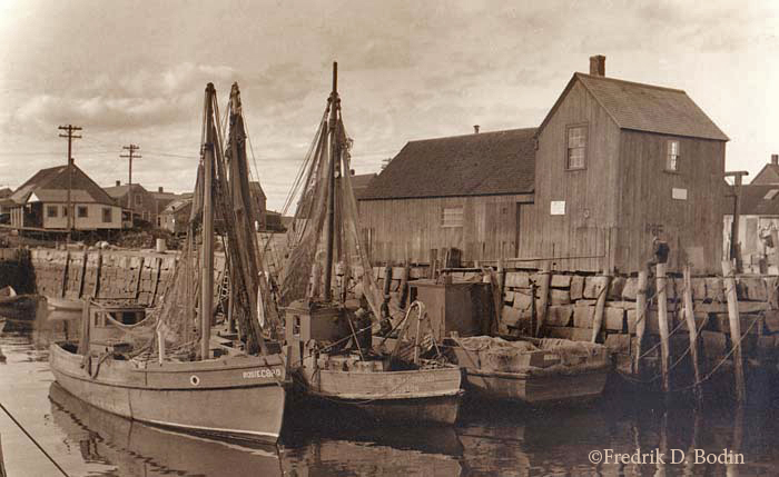 Two mackerel seiners are tied up at Rockport's Bradley Wharf in front of Motif No. 1.  The boats are the Rosie and the Joe D'Ambrosio.
