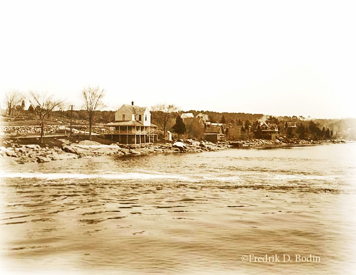"In this photo, the tide is coming into Goose Cove, taken 100 years ago this month. Most of the houses on the shore are still there. Photographer Alice M. Curtis's caption says it's ""taken from the bridge."" She used a tripod to steady her camera, and made a 5x7 inch negative."