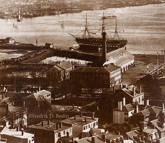 """The Boston Navy Yard was established in 1801 in the Charlestown neighborhood of Boston. The facility built 130+ naval warships, including the USS Constitution in 1814. The Frigate USS Wabash is seen here serving as a receiving or barracks ship, which she did from 1876 until being sold in 1912. The 30 acre Navy Yard is now part of the Boston National Historical Park and home of """"Old Ironsides,"""" the oldest commissioned warship in the world."""