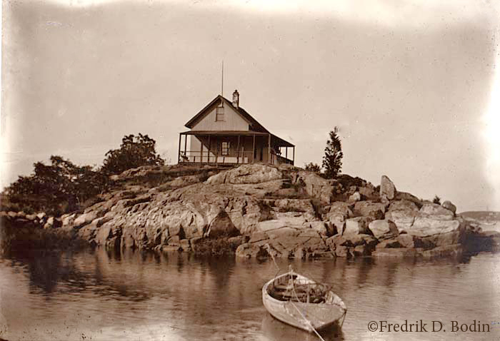 Here's a cottage on Merchant's Island about 1900, with a moored dory with fish traps. A few hardy summer residents of Merchants have visited the gallery. I noticed they frequently looked outside at the weather. That's understandable - it's a long row home.
