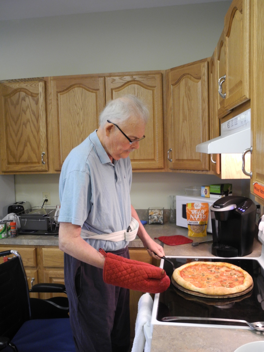 Part of OT (Occupational Therapy) is preparing to survive at home, including cooking in your kitchen. As the group discussed their favorite pizza parlors in Gloucester, I volunteered to make a pizza from scratch for everyone. I hadn't made one in 30 years. I mixed a simple pizza sauce and let it age in the 'fridge overnight. The next day I shaped the pizza dough with the guidance of staff member Kayla, who also throws pizzas for Sebastian's Pizza. After topping the sauced pizza with mozzarella cheese, onions, mushrooms, and linguica, it went into a hot oven on a hot stone. It tasted great, so I guess I'll survive when I'm released.