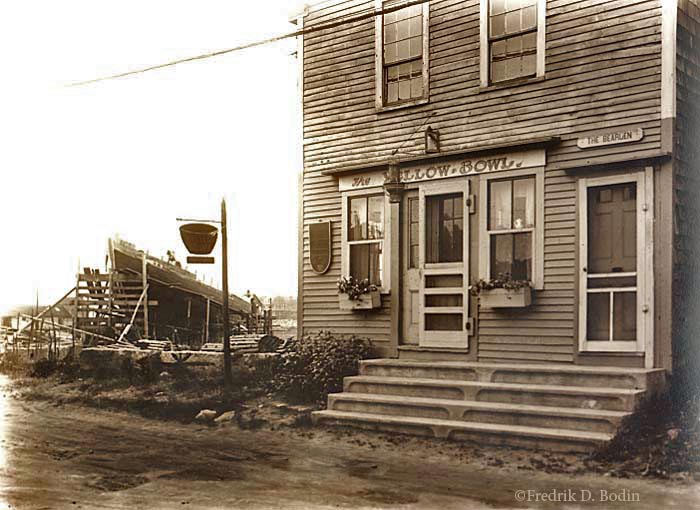 The Yellow Bowl was a tea house on Bearskin Neck. Waddell's shipyard on Bradley Wharf is in the background on the left. The building is still there.