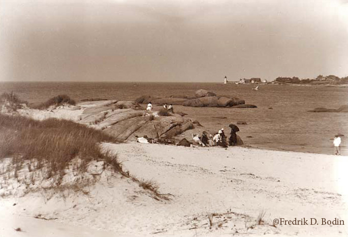 Here's Wingaersheek Beach, with 'Squam Point and Annisquam Light in the distance. Although the fashionable beach goers are fully clothed, this may be a hot day in the summer.