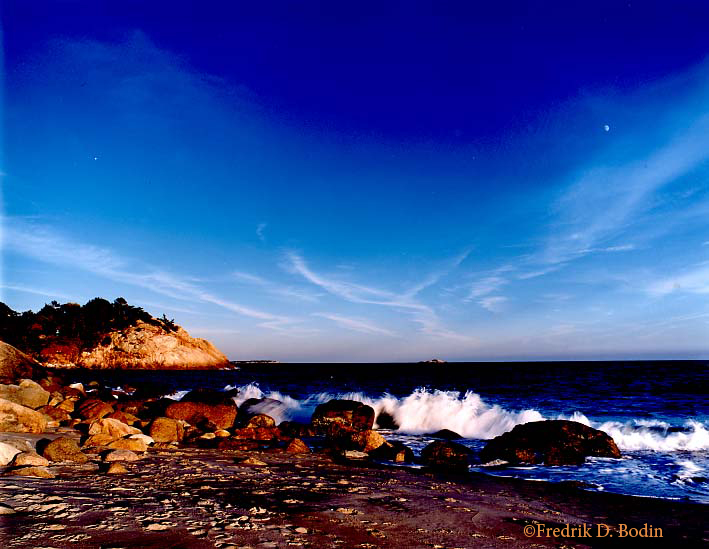 Warm October light enriched the colors and made lengthened the shadows on the beach. The setting sun revealed the moon and a star. This transparency was shot on a tripod with Fuji Velvia film with a Pentax 6x7 (cm) camera. The wide angle 55mm lens accentuated the blue sky. Except for adding my watermark (©Fredrik D. Bodin), no filters or digital manipulation were used.
