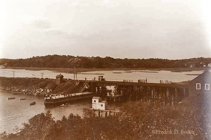 The Railroad Bridge, which crosses the Annisquam River in Gloucester, was a crucial link to the mainland, carrying visitors, goods. The Eastern Railroad built the Gloucester line in 1847, and it was extended to Rockport in 1861. These fishermen seem to be onto the fish, but even today, it's not a safe place to fish from.