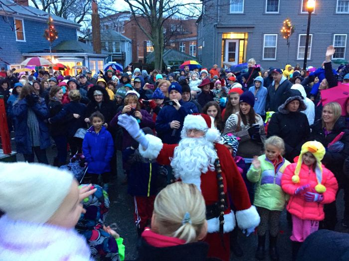 This crowd just a small fraction of the thousands who braved the weather to greet Santa Claus.