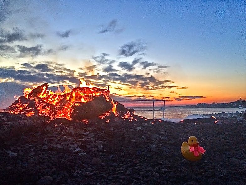 Before you know it the planet wobbles the other way and it is 4th of July in Rockport and Rubber Duck is getting soft in the heat from the leftover bonfire.