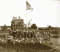 """Civil War veterans of the Grand Army of the Republic, raising the flag in front of Addison Gilbert Hospital in Gloucester, 1904."""