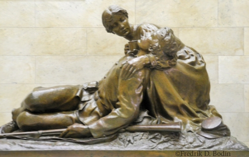 """""""To the Army Nurses from 1864 to 1865 – Army of Mercy and Life Amide Scenes of Conflict and Death."""" This State House statue reminded me of the army of medical professions, especially nurses, who have kept me alive for the past thirteen months."""