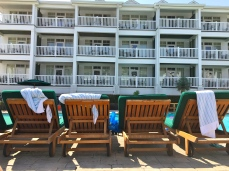 Our pool view. Empty seats...claimed all day long.